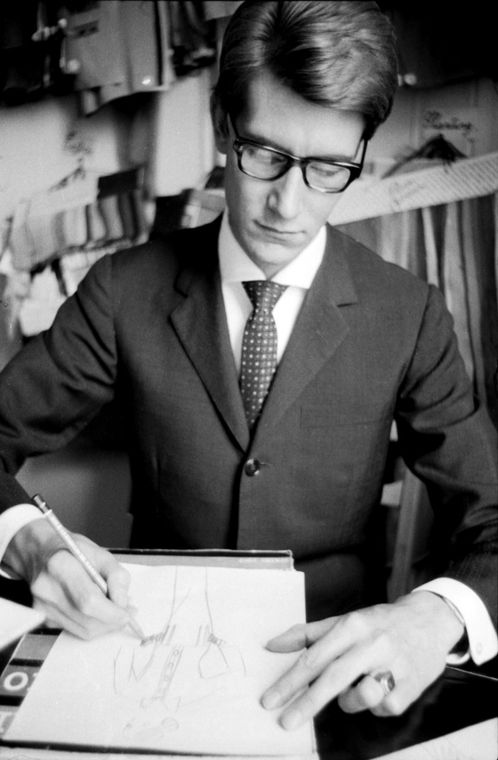 Yves Saint Laurent sketching in his Paris studio. Norman Parkinson was sent to photograph the designer in his studio and atelier for Queen magazine in July 1963.