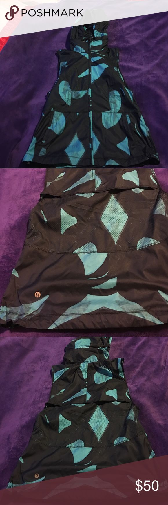 Lululemon vest Only worn once! Teal and navy blue with a print. Hide away zipper pouch to tuck hood in. Deep pockets for phone. Size 6 but fits more like a 4. lululemon athletica Jackets & Coats Vests