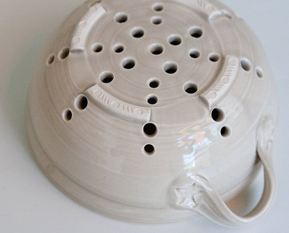 Kitchen strainer and saucer for serving up berries.