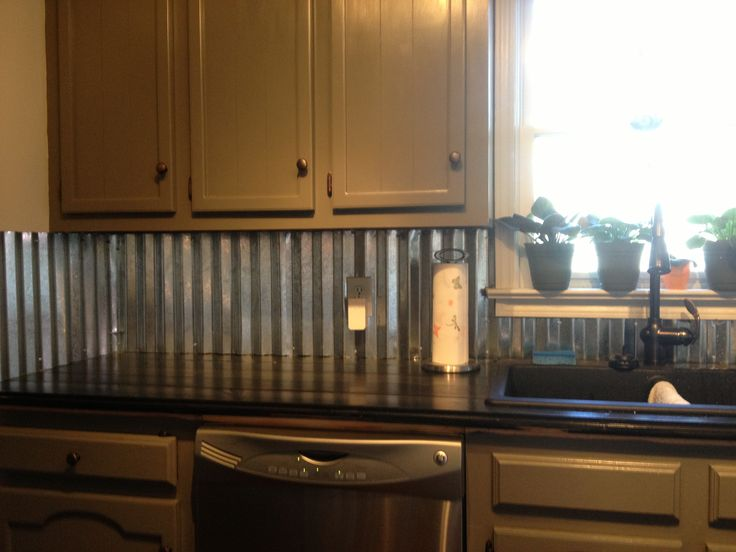 Corrugated metal backsplash, I really like this idea, very rustic!