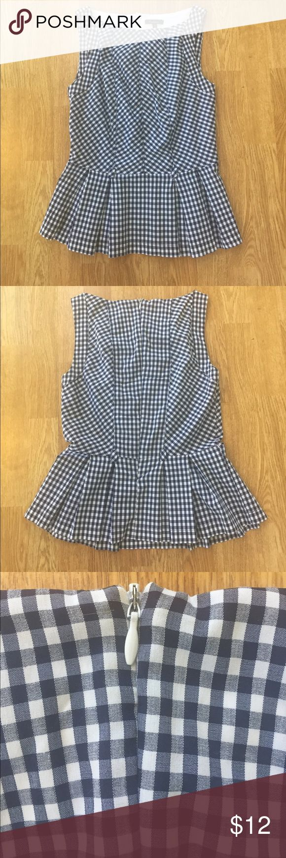 Navy and white plaid peplum shirt Wear to your next dressy casual party! Has a zipper on the back and belt loops. Monteau Tops Blouses