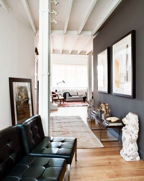 Dark Gray And White Hallway With Rug And Large Art To