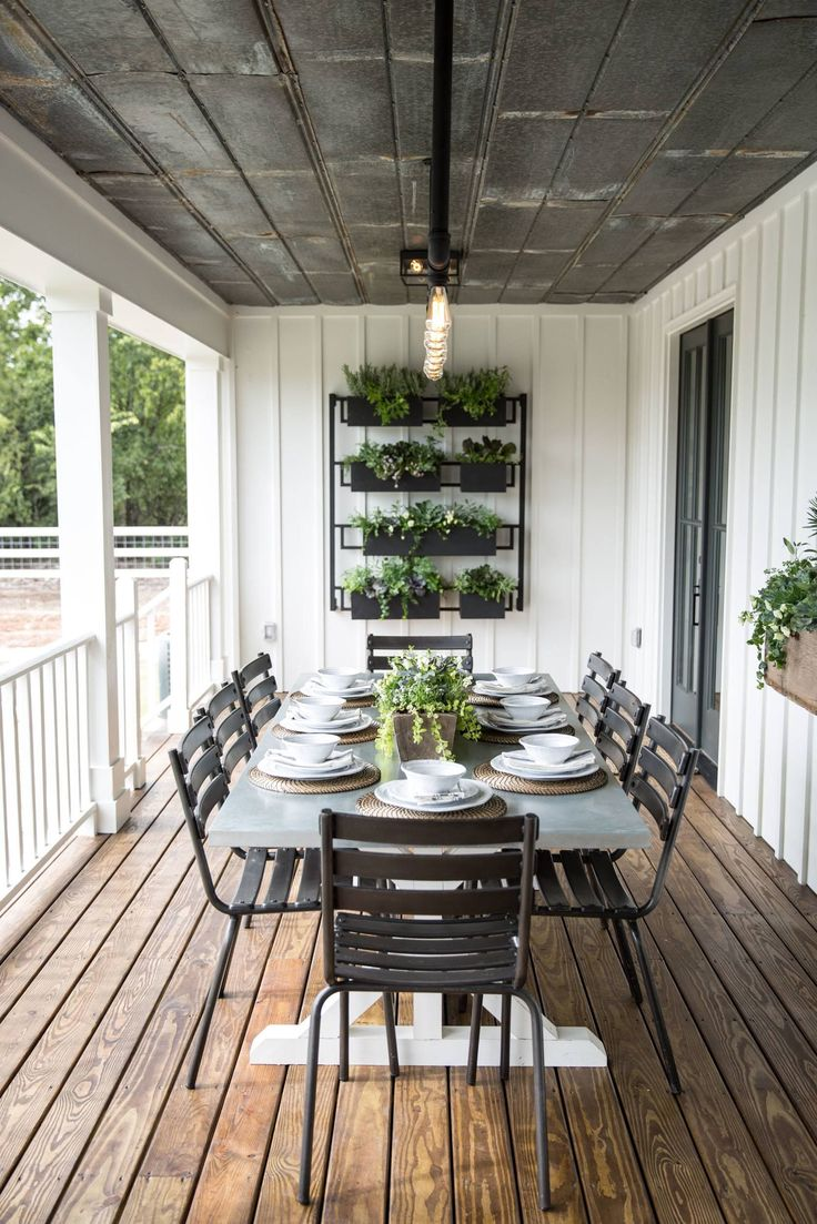 Black iron planters, a black iron light fixture and a custom metal sign personalized the outdoor patio and made it a perfect space for family dinners together.