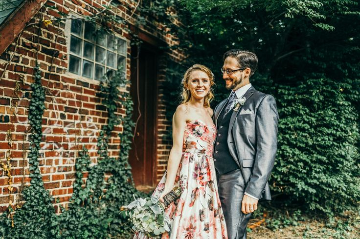 Floral wedding dress + metallic grey suit | Image by The Markows Photography