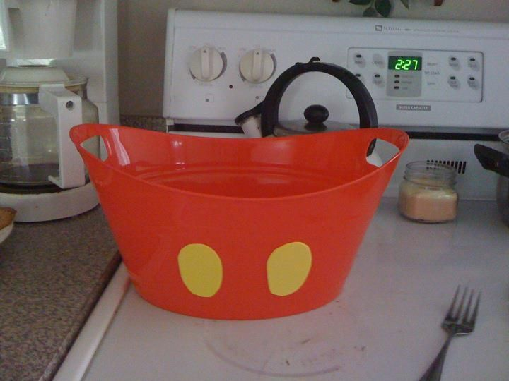 found these at the dollar store in all dif sizes...just stuck yellow buttons on them! POOF... you got mickey mouse buckets ;)
