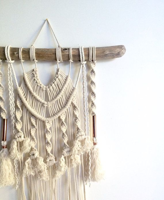 Welcome to Home Vibes where the free spirit and creative soul are celebrated!  ABOUT THIS PIECE - MAJESTIC Bordering tassels and copper piping make the fan of knots Majestic a little beauty. Each piece is made by hand (both of my hands, actually) using natural unbleached cotton and revived driftwood from local beaches along the East Coast of NSW and Queensland, Australia. The copper is polished and coated to prevent excess tarnish. She measures roughly 55cm x 60cm so will fit anywhere and…