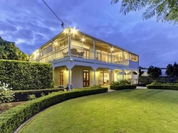 Timber queenslander house exterior with balcony & feature lighting
