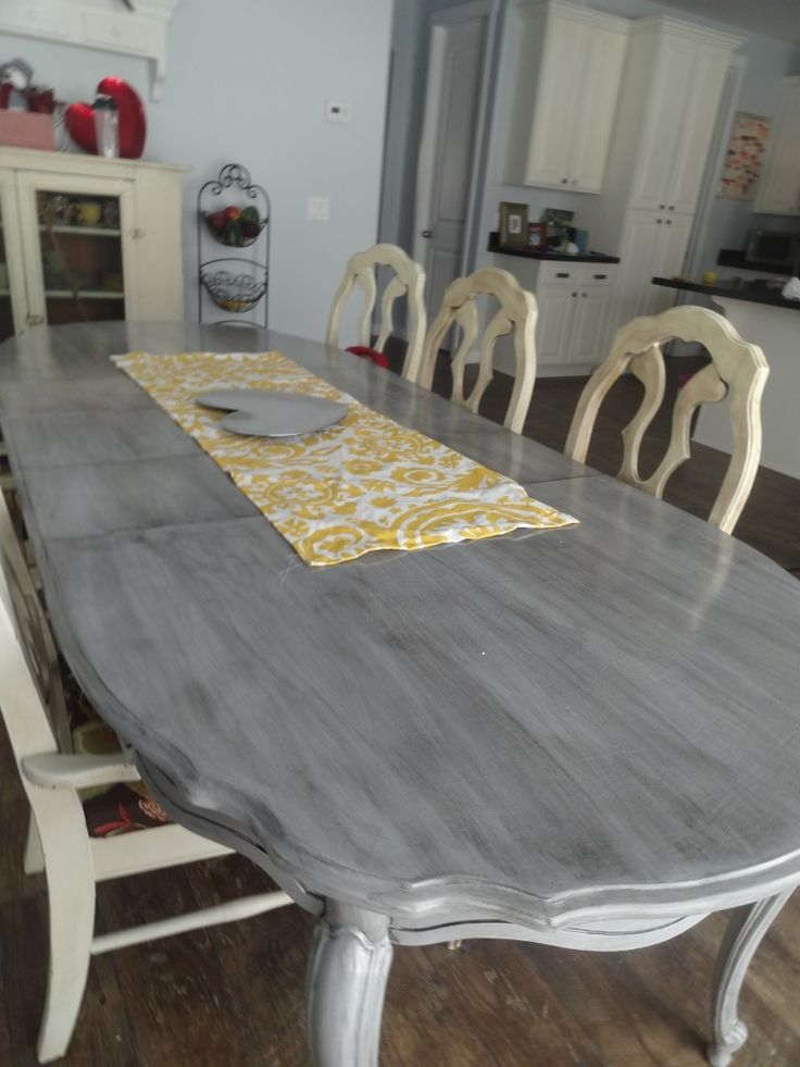 Tips how to refinish your kitchen table. Step by step instructions for priming, painting, and giving a gray white-wash look. Beachy and beautiful.