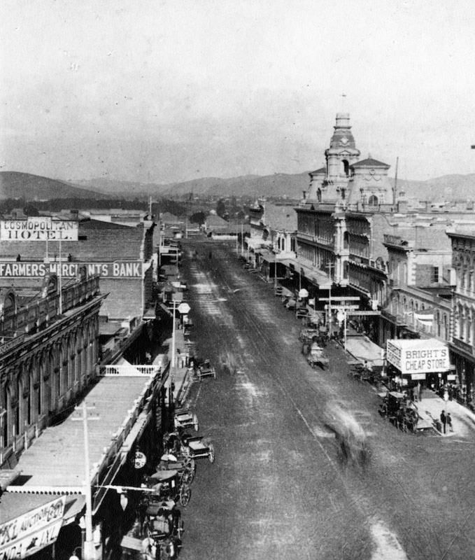 Main Street in Old Los Angeles, circa 1882. On the left is the Farmers and Merchants Bank and the Cosmopolitan Hotel. On the right is Bright's Cheap Store.