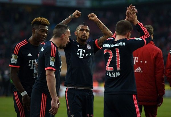 Bayern Munich's Chilean midfielder Arturo Vidal (C) and his teammates react after the German Bundesliga first division football match between FC Cologne vs FC Bayern Munich in Cologne, western Germany, on March 19, 2016.