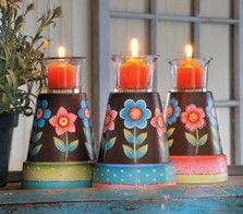 Iluminacion improvisada con unas pequeñas macetas y velas