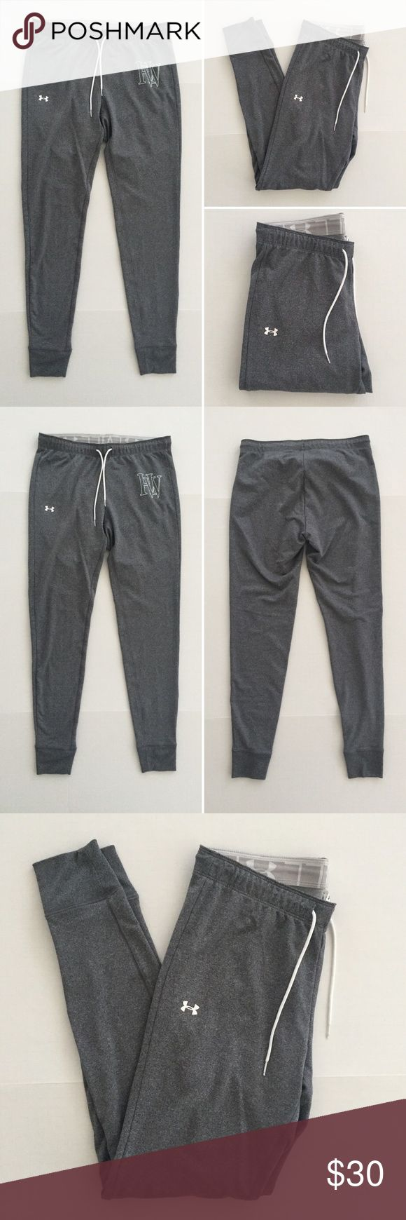 "[Under Armour] women's athletic jogger pants S-M [Under Armour] women's athletic jogger pants S-M •🆕listing •great pre-owned condition •medium dark heather grey with white screen logo (no cracking) and ""HW"" (some cracking) •elastic drawstring waistband, can be folded over to reveal ""I Will"" and UA logo •length/inseam 29"" •may fit S-M, tag size M semi-fitted •material 93% polyester 7% spandex •offers welcomed using the offer/bundle for best discount• Under Armour Pants Track Pants & Joggers"
