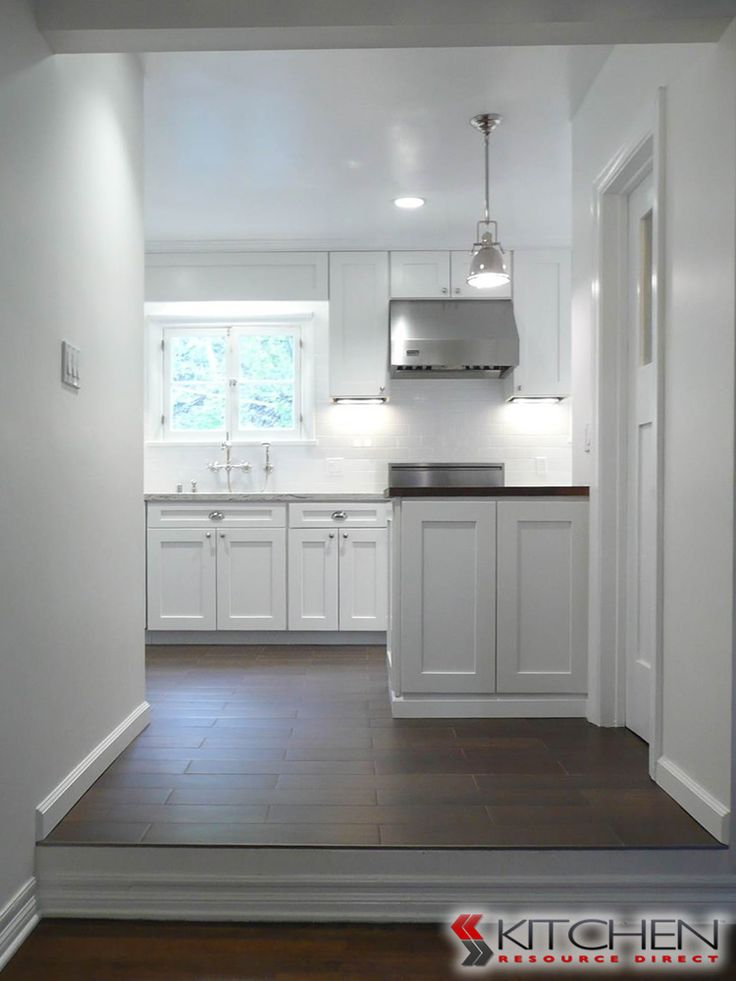 bright white kitchen using shaker style cabinets