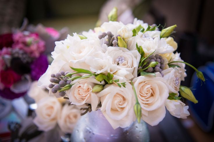 Cream roses, freesia and silver brunia