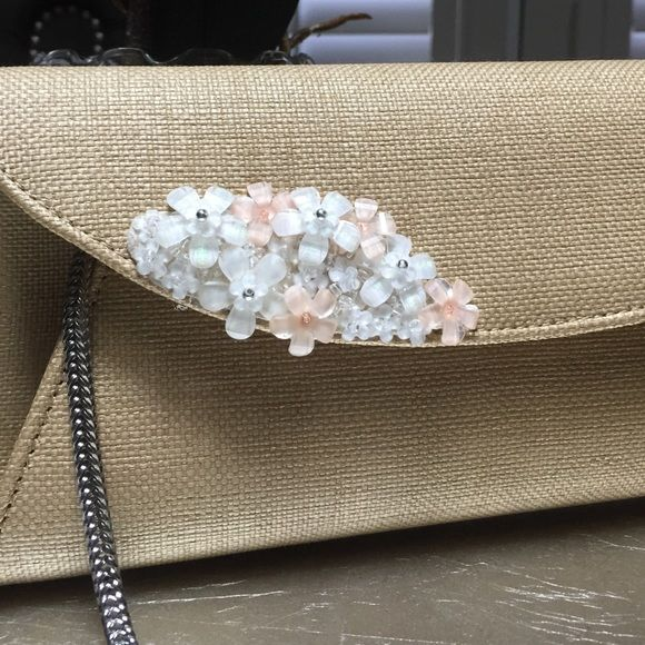 Kate Middleton L.K. Bennett clutch This stunning clutch is in brand new condition. It was used for my rehearsal dinner and that is it. This is Kate Middleton's favorite handbag brand! Retails for $385 L.K Bennett Bags