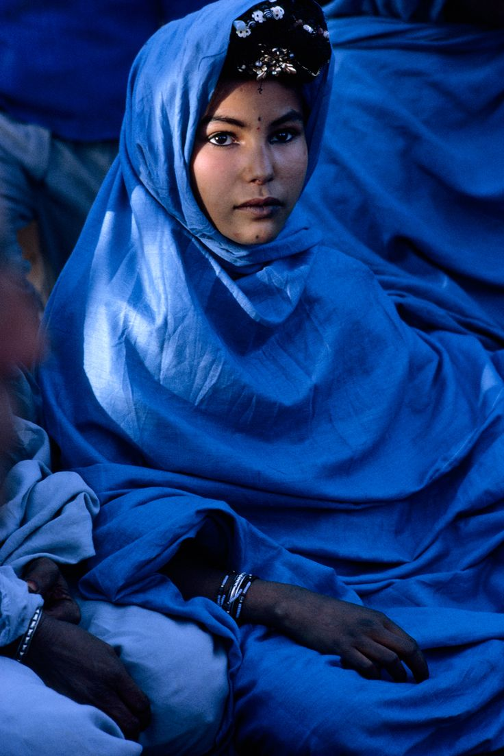 A nomadic Reguibat woman in Algeria poses in traditional blue robes, November 1967.Photograph by Jonathan Blair, National Geographic #BLUE