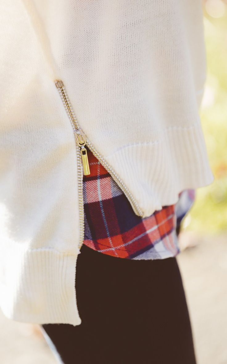 Love adding an unexpected edge to any outfit with my cream Bisou Bisou side-zip sweater.