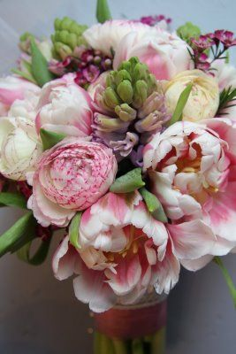 double parrot tulips, ranunculas, wax flowers and hyacinths