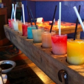 Another angle, 4-oz shot glasses with frozen ritas in a candle votive holder.  Idea from Taco Garage in San Antonio tx