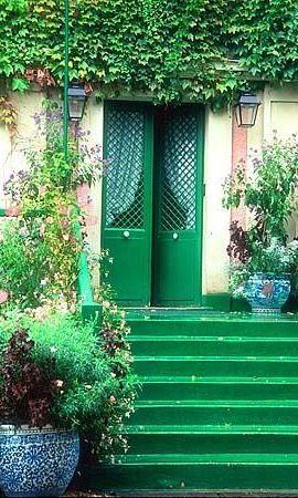 Green door and steps