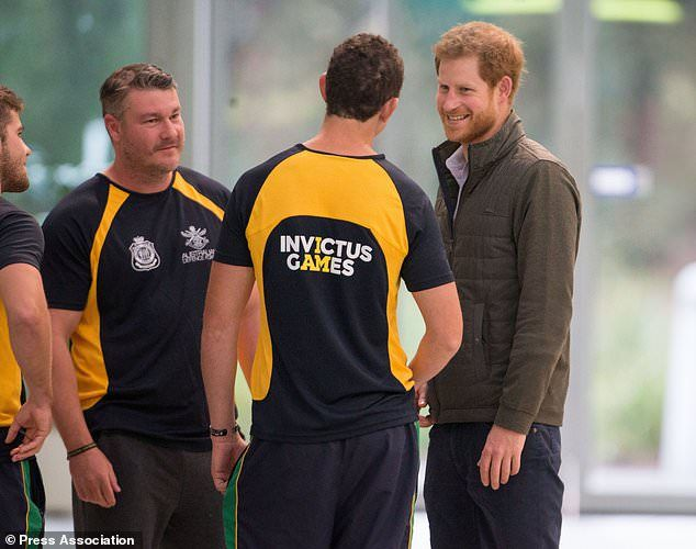 Prince Harry speaks to members of the Australian Invictus Games swimming squad (Steve Pars...