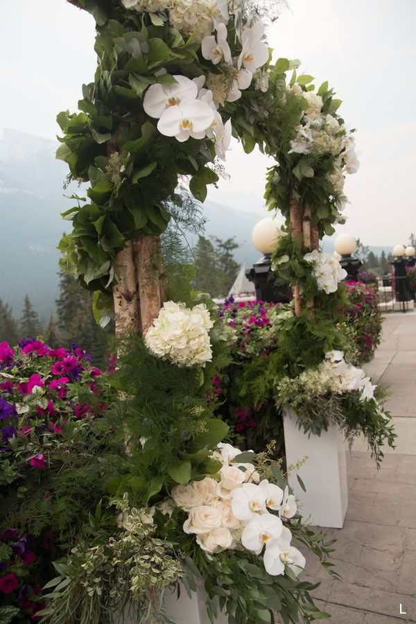 Greenery and Orchid Archway with Birch Accents