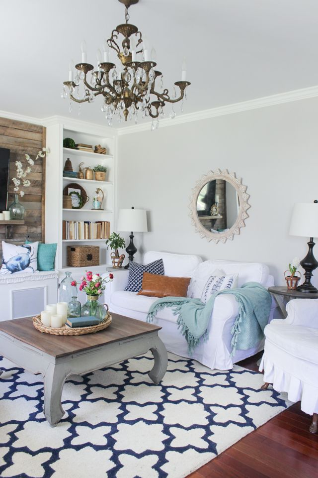 Cozy Spring Home Tour - navy, aqua, and white living room with rustic accents