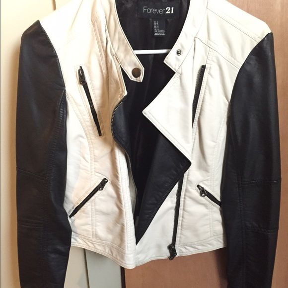 Faux leather jacket Black and white forever 21 black and white jacket. I only wore it once, super slimming! Forever 21 Jackets & Coats