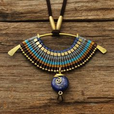 Woven tribal necklace with lapis lazuli set into par cafeandshiraz, $86.00