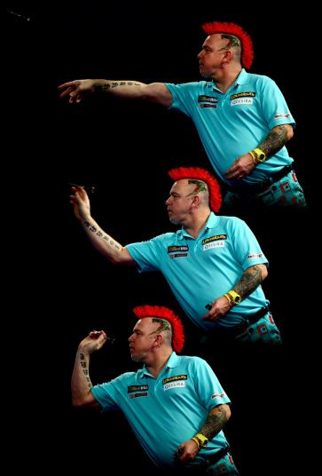 Peter Wright of Scotland in action during his third round match against Dave Chisnall of England on Day Twelve of the 2016 William Hill PDC World Darts Championships at Alexandra Palace in London