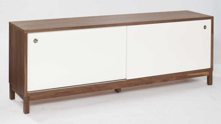 Sideboard The chic looking and spacious sideboard comprises a part solid American black Walnut frame dressed with MDF and real Walnut veneer. The sliding matt white doors conceal 2 integral drawers, providing useful additional storage.  Dimensions:  L2000mm x W450mm x H750mm NB - This product comes fully assembled.