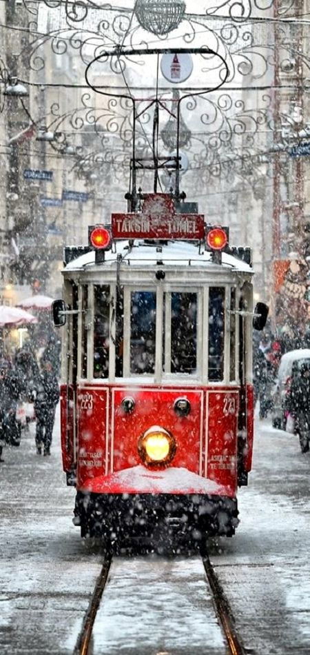 The historic tram on Istiklal Cad. covered in snow in Istanbul,Turkiye.