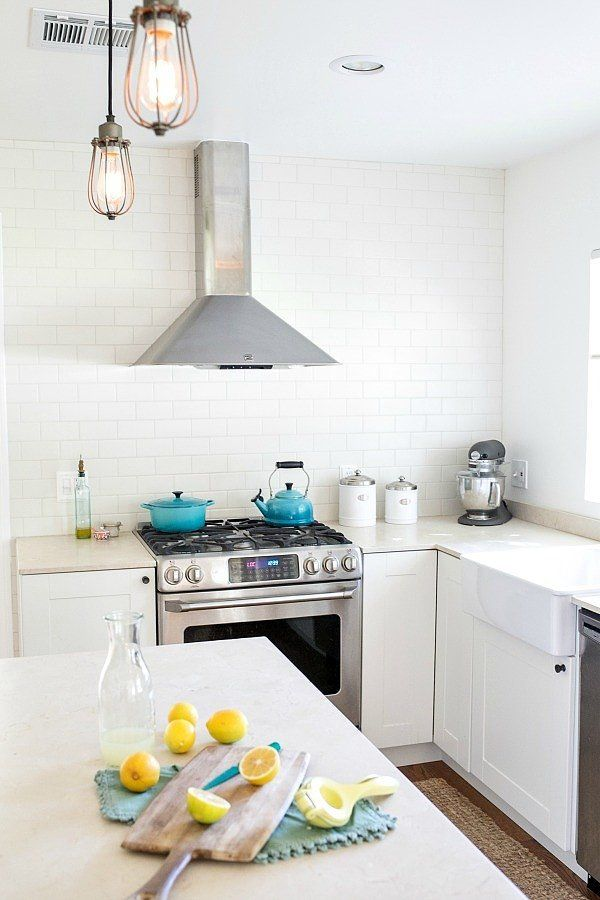 All white Ikea kitchen with turquoise accents