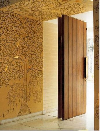 Indian interiors, mix of tradition and modernity Warm dark woods, golden accents with modern art work. Entrance art- striking