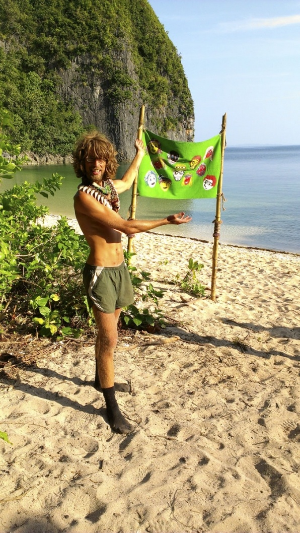 Survivor Photos: Erik shows off the flag on CBS.com