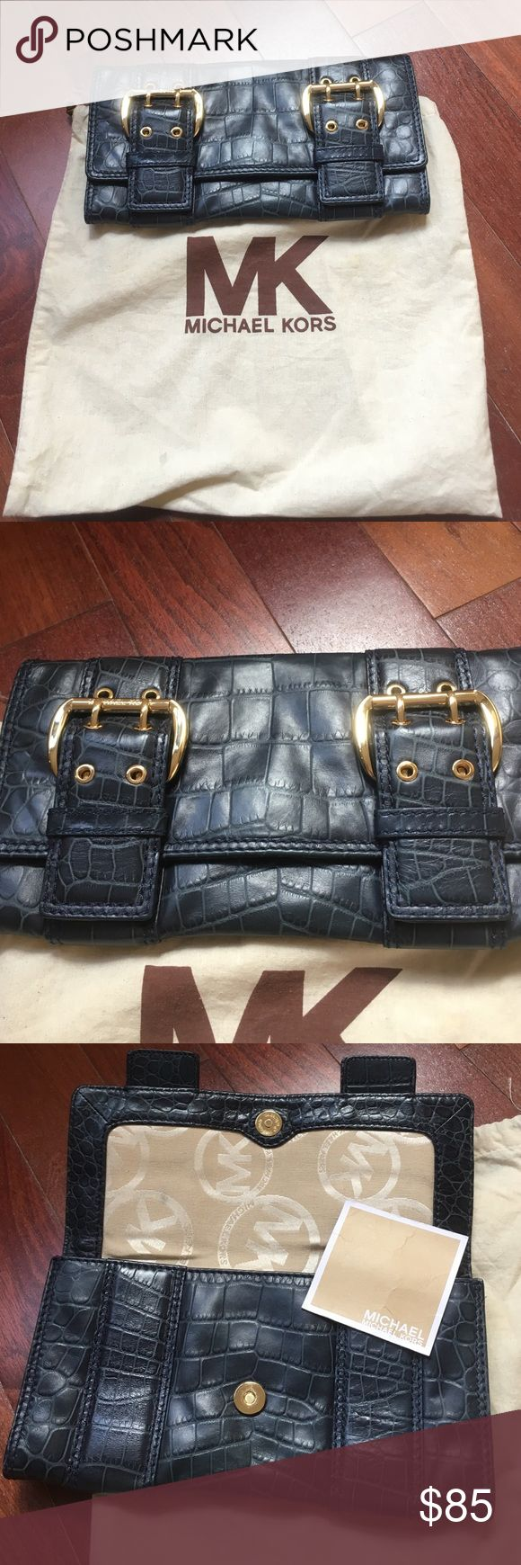 Michael kors navy clutch with gold buckle Navy is the new black. Practically new classic and elegant clutch. Can wear with anything. Michael Kors Bags Clutches & Wristlets