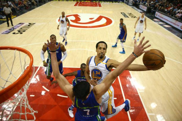 Shaun Livingston of the Golden State Warriors shoots the ball against the Atlanta Hawks on March 6 2017 at Philips Arena in Atlanta Georgia NOTE TO...