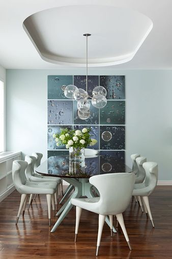 I love the retro inspired table & chairs and the modern light fixture from Anthony Baratta Designs