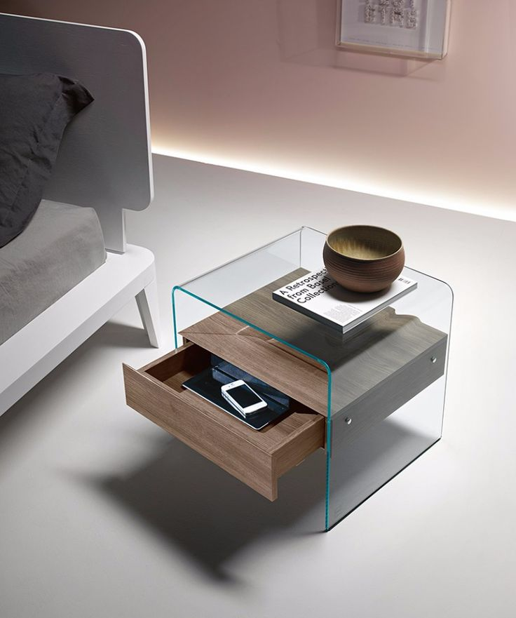 A glass nightstand with charming contemporary features.