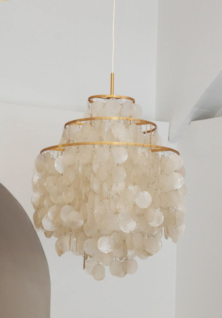 Miranda these are like the ones grandma has in her basement! Ask her about them I'm sure she'll give you one! Capiz Shell Chandeliers by Verner Panton #Filipino