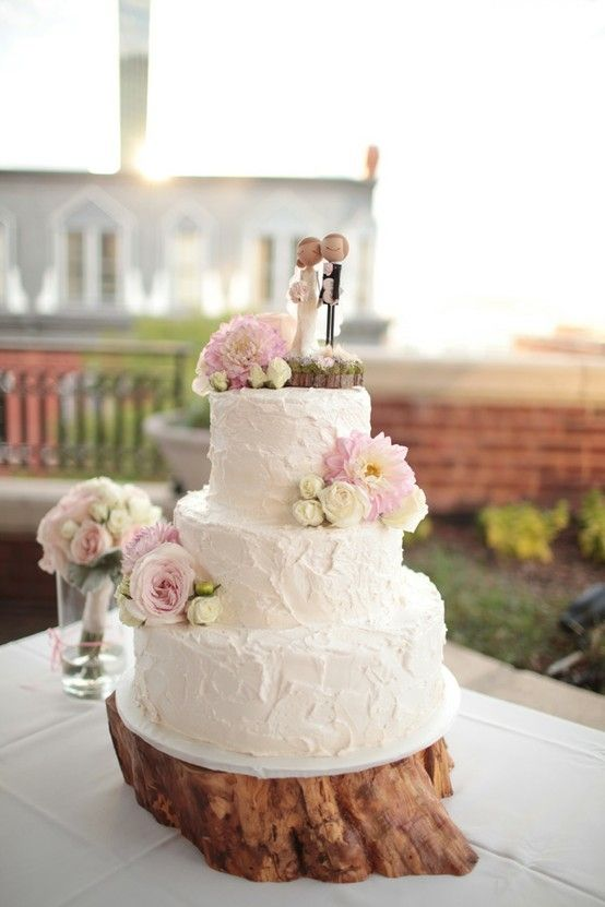 Almost identical to what I want. Smaller flowers, a little smoother texture on frosting. I like how the cake topper is on a wood platform and has flowers next to it.