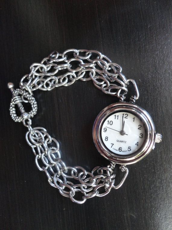 Round face watch with link chained strap and a heart toggle clasp on Etsy, $18.49