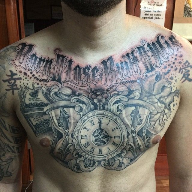 Massive various clocks with human hear and money tattoo on chest with lettering