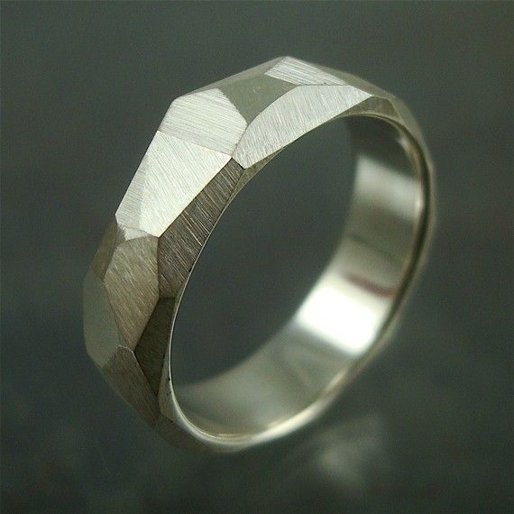 He Rocks!  Broad facets cover the surface of these sterling silver rings creating a chiseled rock look. It has a soft satin finish on the outside