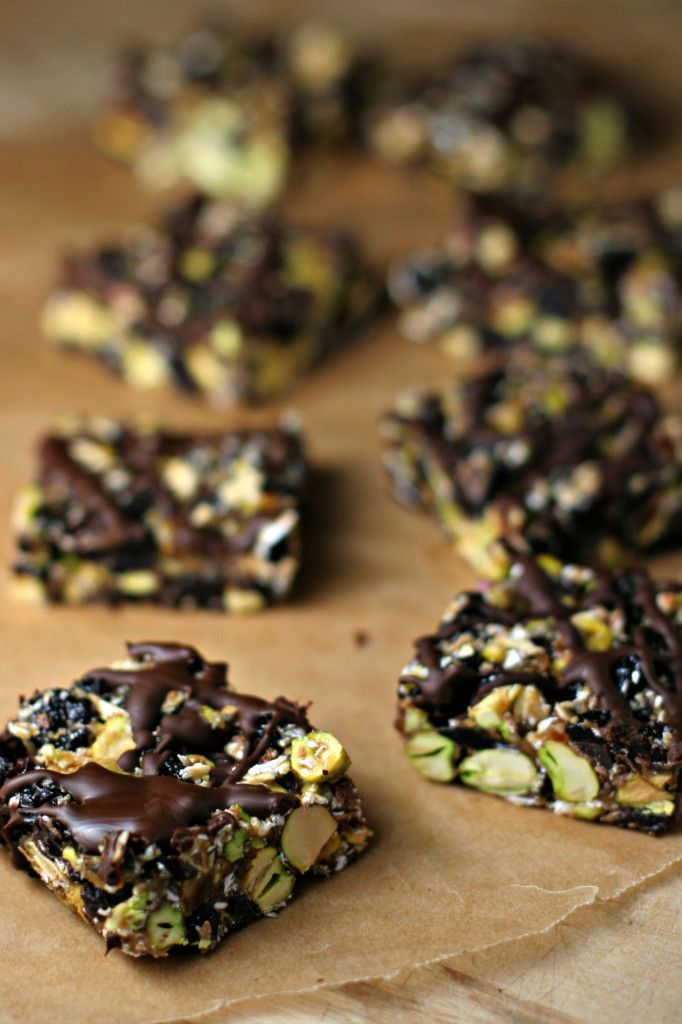 Dark Chocolate Cherry Pistachio Bars, a healthy blend for a sweet and tart on-the-go treat! This month's Recipe Redux asked us to pick a pantry item and revamp it into something amazing, I picked pistachios.  I had a lonely bag of unsalted pistachios kicking around in the back of my pantry since Christmas because let's…