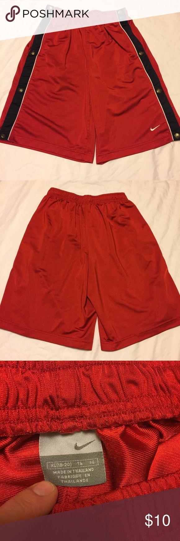 NIKE Shorts Boys NIKE shorts.  Clips on sides.  Size XL(18-20).  Good condition ( except there little spot on back but you cant even see it) check 4th pic Nike Shorts