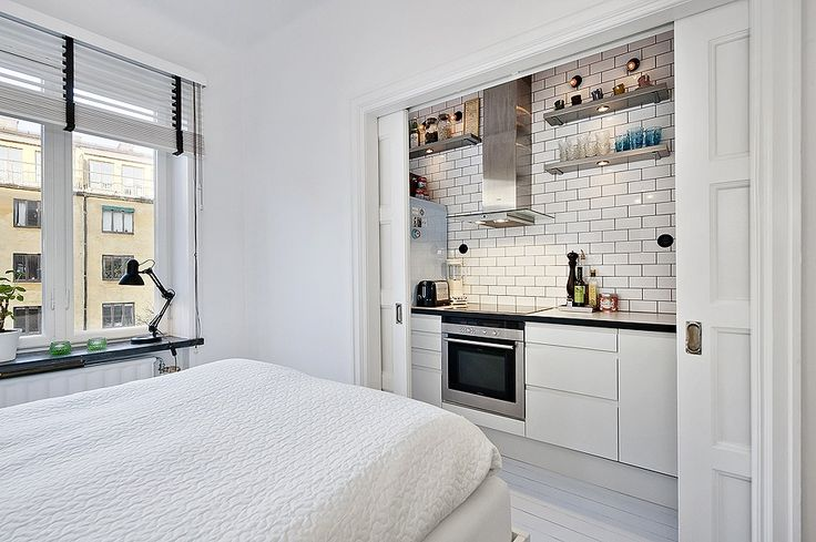 There's so much to love about this 49 square meter Stockholm apartment, but what really caught my eye was the kitchen location — it's in a closet! I've seen closets converted into offices, mudrooms, and even bedrooms, but never a kitchen.