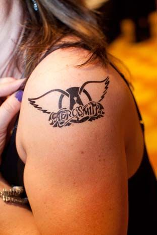Gin C. Productions gave guests temporary tattoos, including one with Aerosmith's logo. Photo: Nathan Fried-Lipski