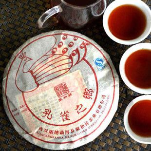 Free Shipping Peacocks Home Old tea trees Cake Yunnan Seven Cakes Puer Tea 2012yr Cooked Ripe Pu er Tea 200g Cake