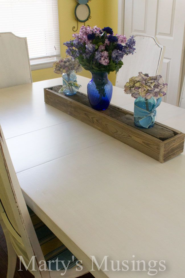 This table went from old to new! Check out the Painted Kitchen Table from Martys Musings